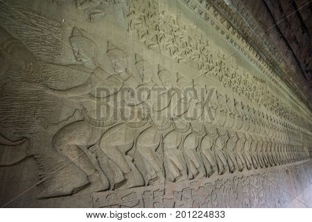 Ancient Khmer bas relief wall carving inside the inner wall of Angkor Wat, Cambodia.