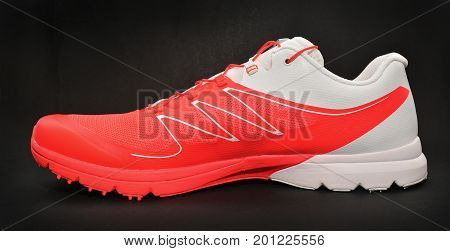 running sport shoe over a dark background