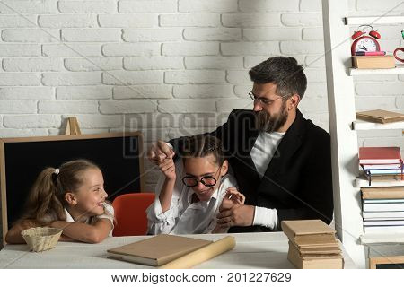 Kid, Elder Sister And Their Father With Happy Faces