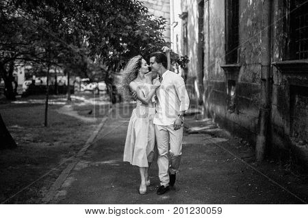 Happy Newlywed Couple On A Relaxing Walk In Sunny Paris During Summer Honeymoon, Smiling Man Hugging