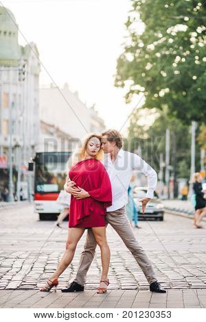 Passionate Hipster Couple Dancing In The Streets, Summer Honeymoon Of Dancers Couple In Stylish Red