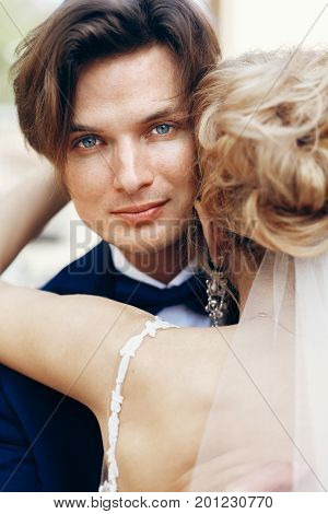 Happy Newlywed Groom Hugging Bride After Wedding Ceremony Outdoors Face Close-up, Newlywed Couple Po