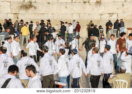 Young Jewish Teenagers Dancing At The Wailing Wall In The Old City Of Jerusalem