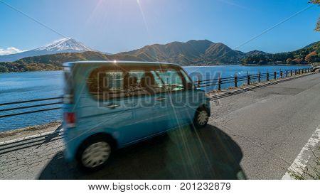 Eco Car Driving Near Mt Fuji With Motion Blur
