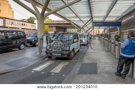 London, the UK - May 2016: taxis at Paddington railway station