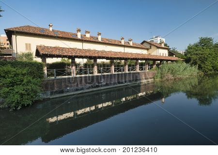 Milan (Lombardy Italy): the canal of Martesana with historic buildings reflected in the water