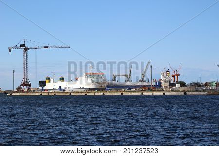 A cargo ship docked at the port of Dunkirk occupied to be loaded by cranes