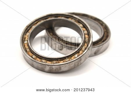some used ball bearings isolated on white