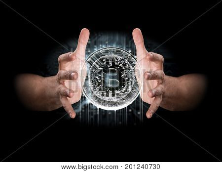 A pair of male hands enveloping a hologram of a bitcoin on an isolated dark background
