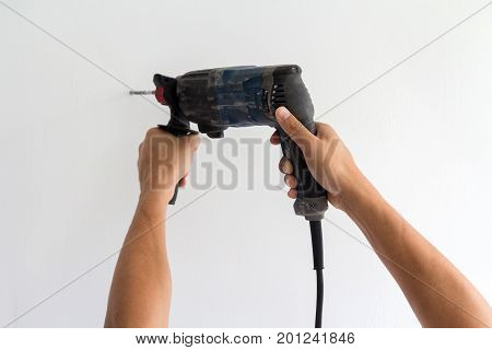 Manual worker hands hold electric screw driver