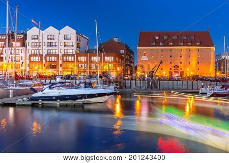 GDANSK, POLAND - AUGUST 13, 2017: Summer scenery of Motlawa river and marina in Gdansk at night, Poland. Gdansk is the historical capital of Polish Pomerania.