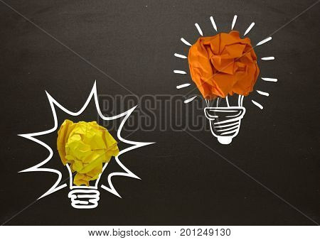 Digital composite of light bulbs on blackboard with chalk and crumpled paper balls