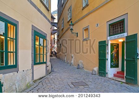 Vienna Austria - April 5 2015: Snapshot of a narrow street in the old city center of Vienna Austria. Shot taken on April 5th 2015