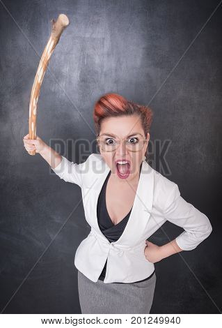 Angry Screaming Teacher With Wooden Stick