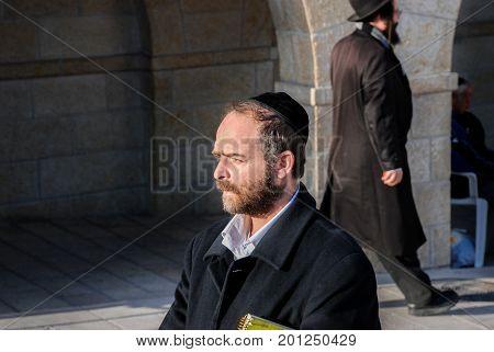 JERUSALEM ISRAEL - FEBRUARY 21 2009: Orthodox Jewish man near the Western Wall. Jerusalem. Israel