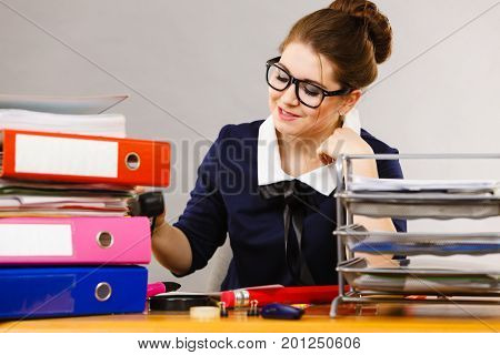 Business Woman In Office Writing Something Down