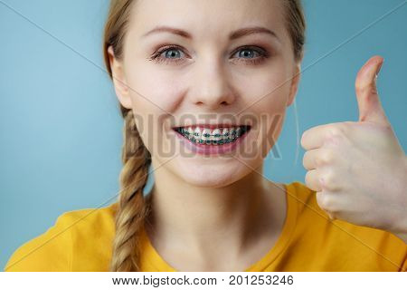 Young Woman Showing Teeth Braces