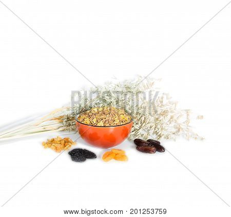 Cornflakes with raisins, dried apricots, prunes, dates Isolated on white background