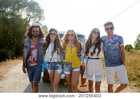 summer holidays, road trip, travel and people concept - smiling happy young hippie friends near minivan car