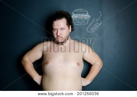 Fat man. Health, sports and diet. Problems with excess weight and stress. Funny guy. Studio.