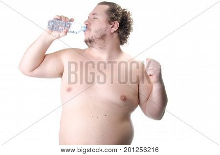 Thirst. overweight man drinks water. Health, sports and diet.