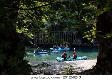 Adventure Team Doing Rafting Of The Voidomatis River In Zagori
