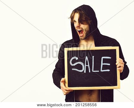 Bearded man short beard. Caucasian sexy young macho in hood with stylish hair and moustache on shouting face holding black board with sale inscription isolated on white studio background