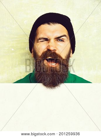 Bearded Man Posing On Studio Wall Background