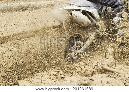 Motocross accelerating  speed  in muddy track .