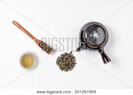Green Tea In Tea Pot On White Background. Top View