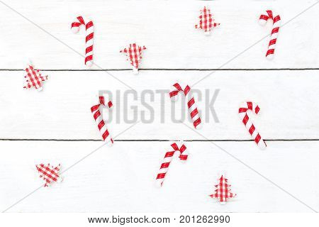 Christmas background. Christmas toys and candy canes on a white wooden background