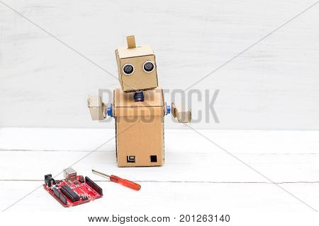Robot with hands and screwdriver with printed circuit board