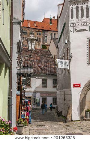 CESKY KRUMLOV, CZECH REPUBLIC - AUGUST 13, 2017: Tourists walking in the medieval street of Cesky Krumlov city