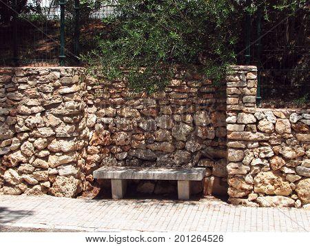 Slatted bench at the sidewalk on Mallorca Island