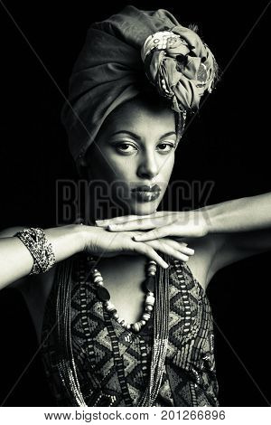 African black young woman beauty portrait with turban headscarf and traditional  clothes studio shot bw