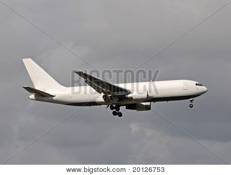 Unmarked cargo jet airplane in white color poster