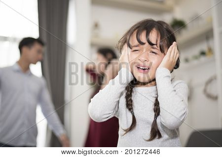 Little girl was crying because dad and mom quarrel, Sad and dramatic scene, Family issued, Children's Rights abused in Early Childhood Education and Social and parrents care problem concept