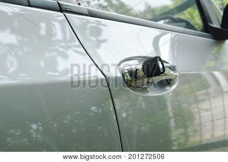 car key stabbing in handle hole for open door
