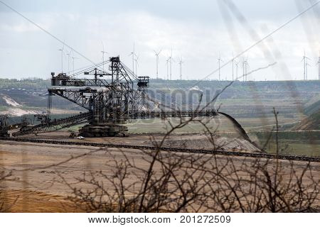 heavy machine in Garzweiler opencast mining lignite North Rhine-Westphalia Germany controversial energy production against environmental protection arouses strong protest in the population