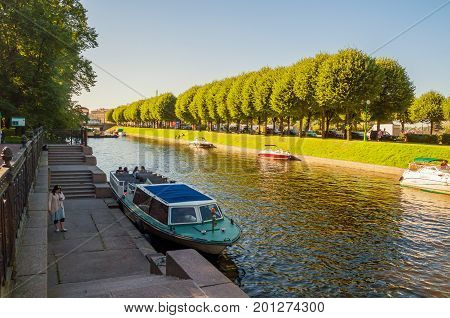 ST PETERSBURG RUSSIA - AUGUST 15 2017. Water area of Moika river in summer in St Petersburg Russia. City landscape with pleasure boats floating on Moika river in St Petersburg Russia
