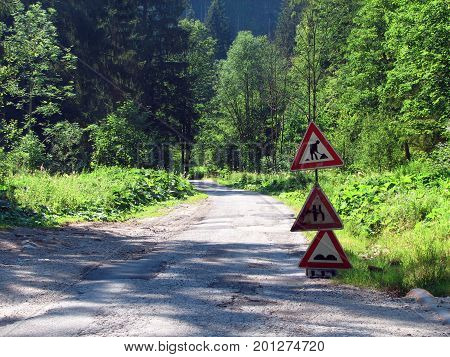 Damaged way through nature erosion, road in nature