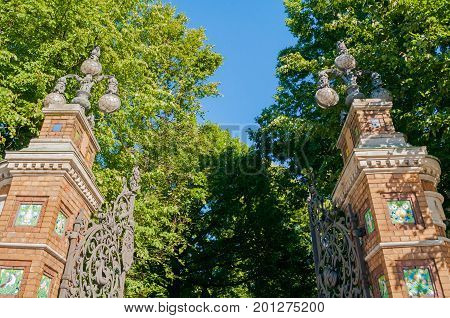 St Petersburg Russia. Fence of the Michaels Garden in St Petersburg Russia in sunny summer day. Architecture view of St Petersburg landmark framed by park green trees