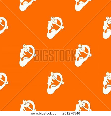 Human ear with piercing pattern repeat seamless in orange color for any design. Vector geometric illustration