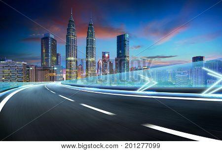 Speedy motion forward flyover with beautiful Kuala Lumpur city skyline Twilight scene .