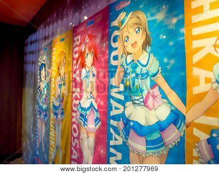 TOKYO, JAPAN - DECEMBER 28, 2011: Comic anime advertisement in central Tokyo. Anime abbreviation for animation is a popular trend in Japan and has a large audience and recognition world wide.