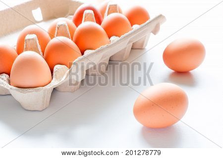 Chicken eggs close up and egg box