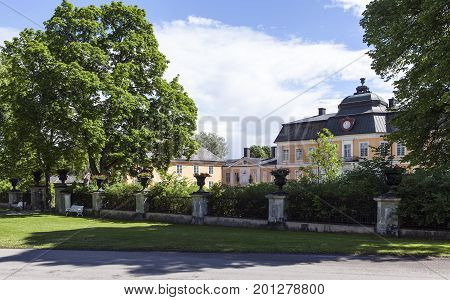 OSTERBYBRUK, SWEDEN ON JUNE 25. View, exterior of Gammel Tammen an old manor, mansion, hotel, restaurant and inn on June 25, 2017 in Osterbybruk, Sweden. Editorial use.