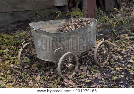 Vintage cart made from an old baby bath and wheels from a baby stroller