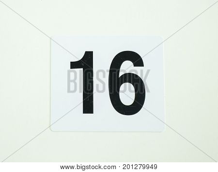 sixteen number sign on isolated white paper
