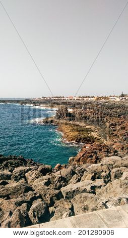 The rocky and volcanic coast and blue waters of Caleta De Fuste Fuerteventura, Canary Islands